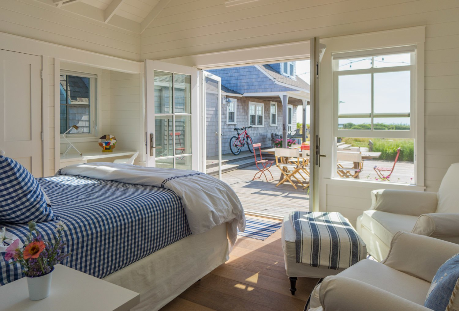 Guest cottage french doors provide welcome access to a sunny iconic courtyard.  Corkin House