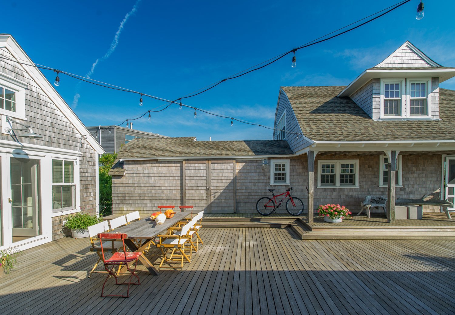 The west side of the courtyard opens magically to Cape Cod Bay and beyond.  Corkin House