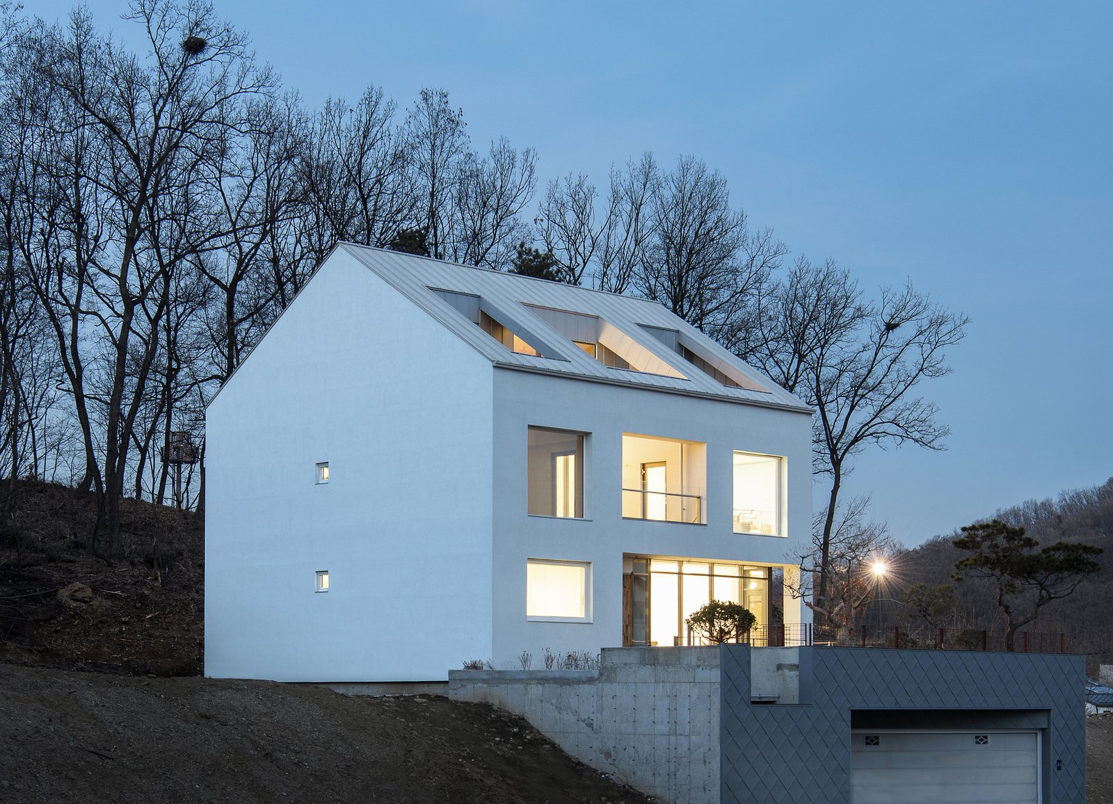 Back Yard, Exterior, Stucco Siding Material, and House Building Type Main Image  A House by Chang Kyu Lee