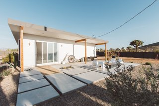 This refurbished home set on 2.5 acres embraces the tranquility of the desert. The home offers an array of lounge areas as well as a hot tub and fireplace to take in the stars. Every room in the house offers desert views, and sliding glass doors connect the living areas to the expansive deck.