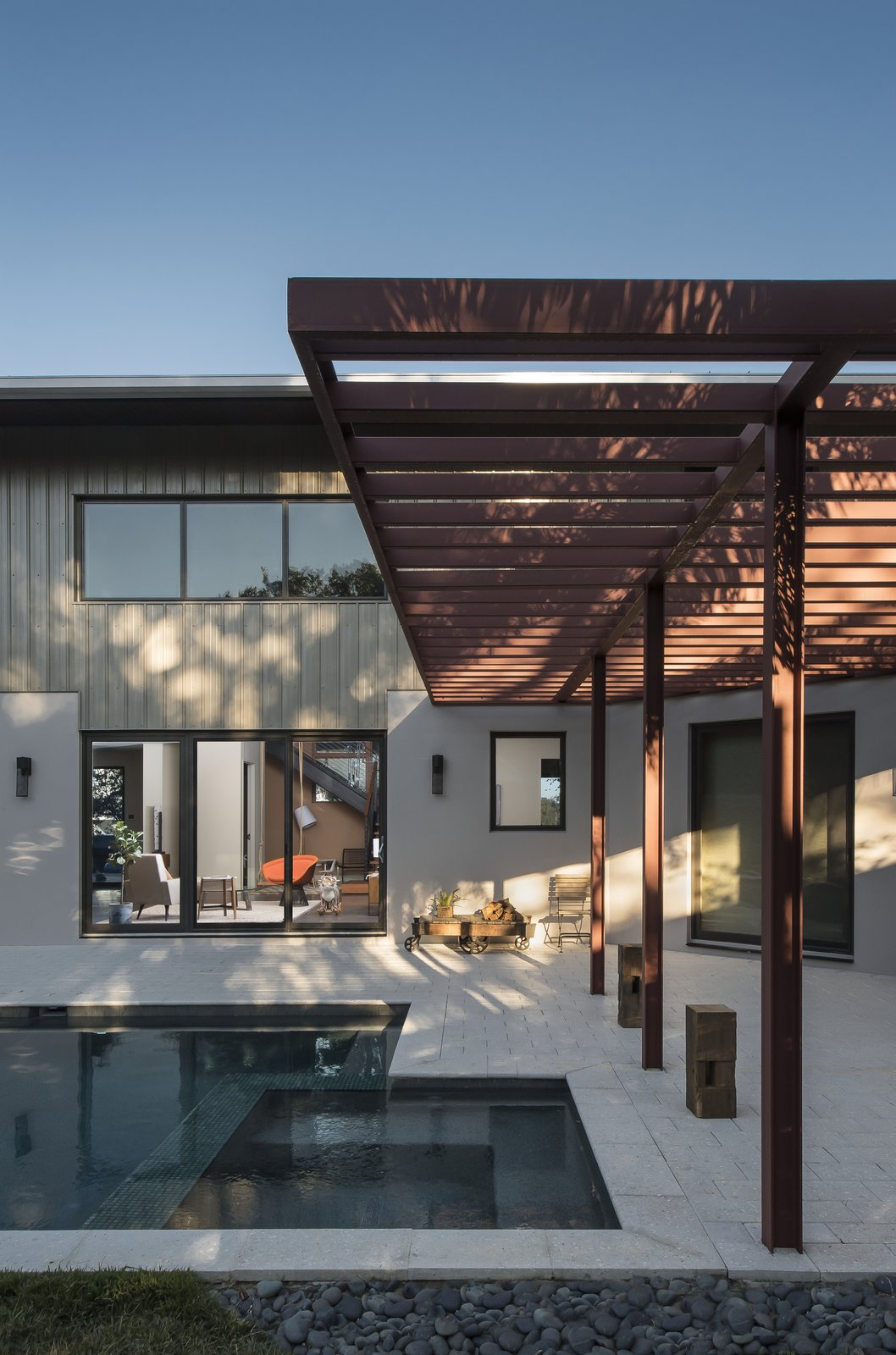 Exterior The sun-shade beside the pool plays with the horizontal and vertical repetition of the exposed beams that are not only the heart of the home's construction but also its design.  1600 Lakeside