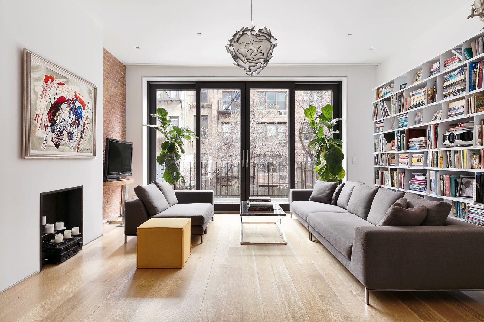 Family room, leads to terrace with skylights illuminating lower level  Uptown Loft