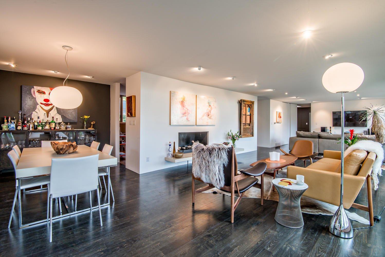 Dining Room, Gas Burning Fireplace, Floor Lighting, Chair, Dark Hardwood Floor, Table, Recessed Lighting, and Pendant Lighting Dining and living   An Eduard Dreier Home asked $1.2M