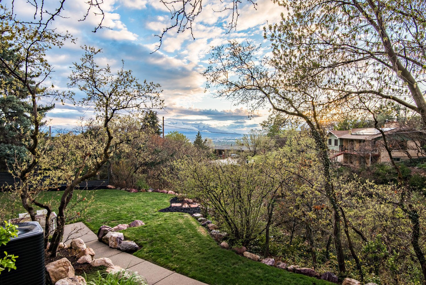 Outdoor, Trees, Shrubs, Walkways, Back Yard, Wood Fences, Wall, and Concrete Patio, Porch, Deck Back yard.   An Eduard Dreier Home asked $1.2M