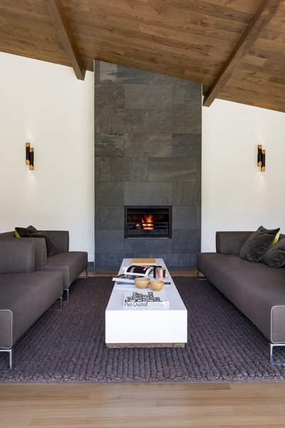 Originally built in the 1960s, this light-filled property underwent a complete program of renovation and extension. A modern fireplace was clad with natural stone to complement the oak ceiling.