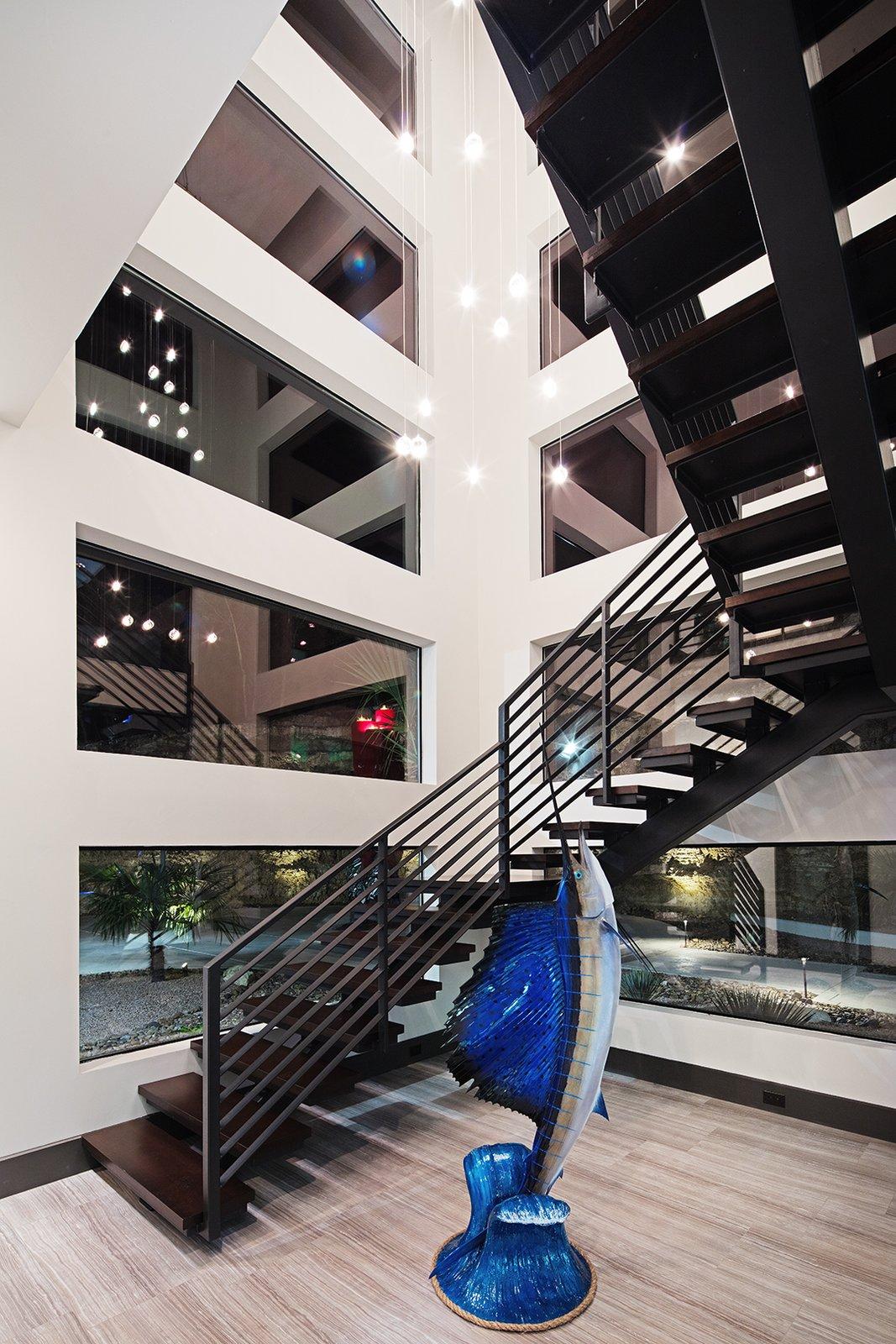 FLOATING STAIRCASE  ALTURA HOUSE by OSCAR E FLORES DESIGN STUDIO