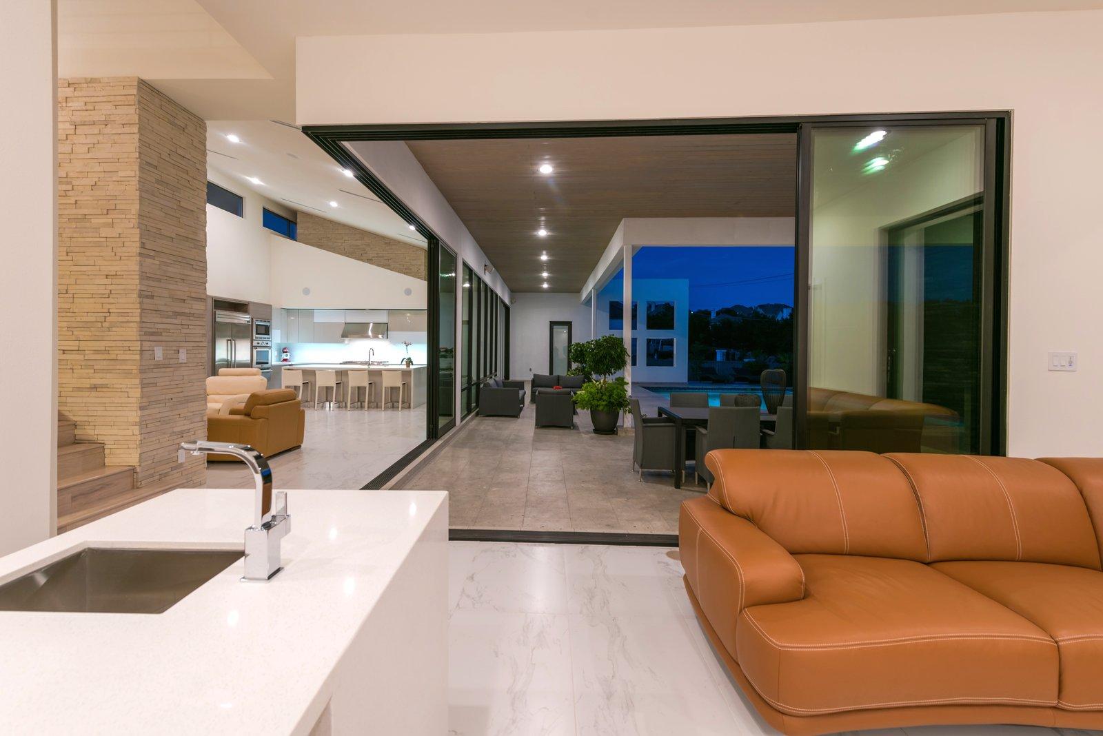 GAMEROOM-BAR  ORVANANOS HOUSE by OSCAR E FLORES DESIGN STUDIO
