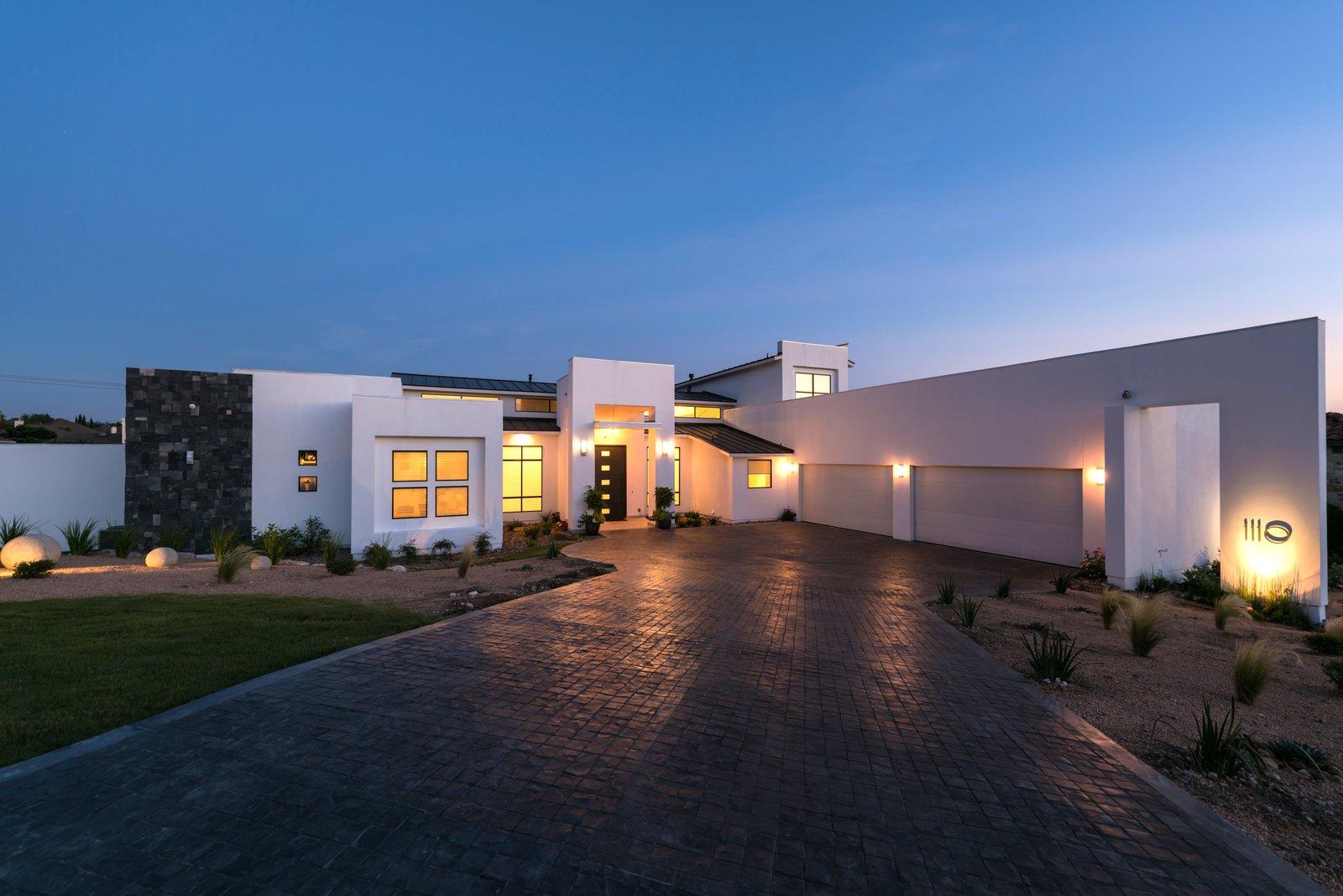 FRONT FACADE NIGHT VIEW  ORVANANOS HOUSE by OSCAR E FLORES DESIGN STUDIO