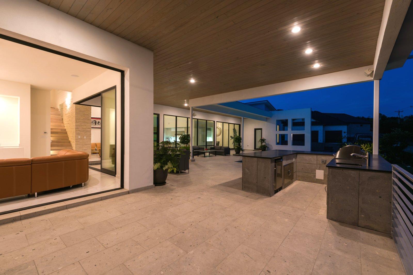 OUTDOOR KITCHEN  ORVANANOS HOUSE by OSCAR E FLORES DESIGN STUDIO