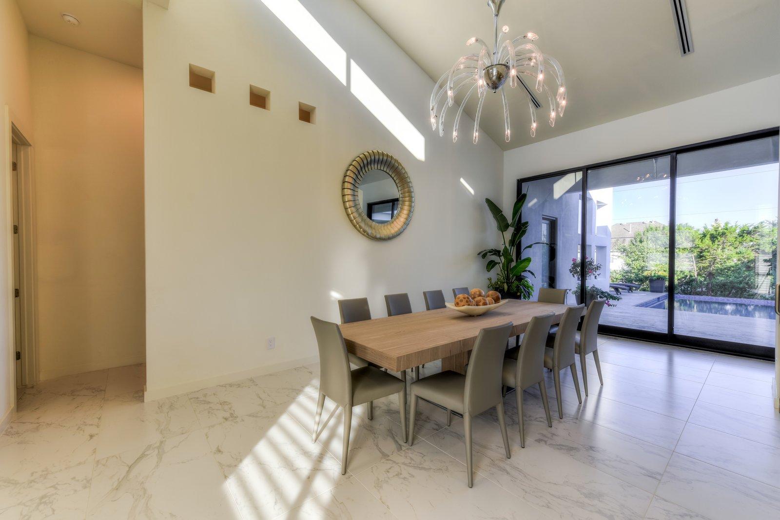 DINING ROOM  ORVANANOS HOUSE by OSCAR E FLORES DESIGN STUDIO
