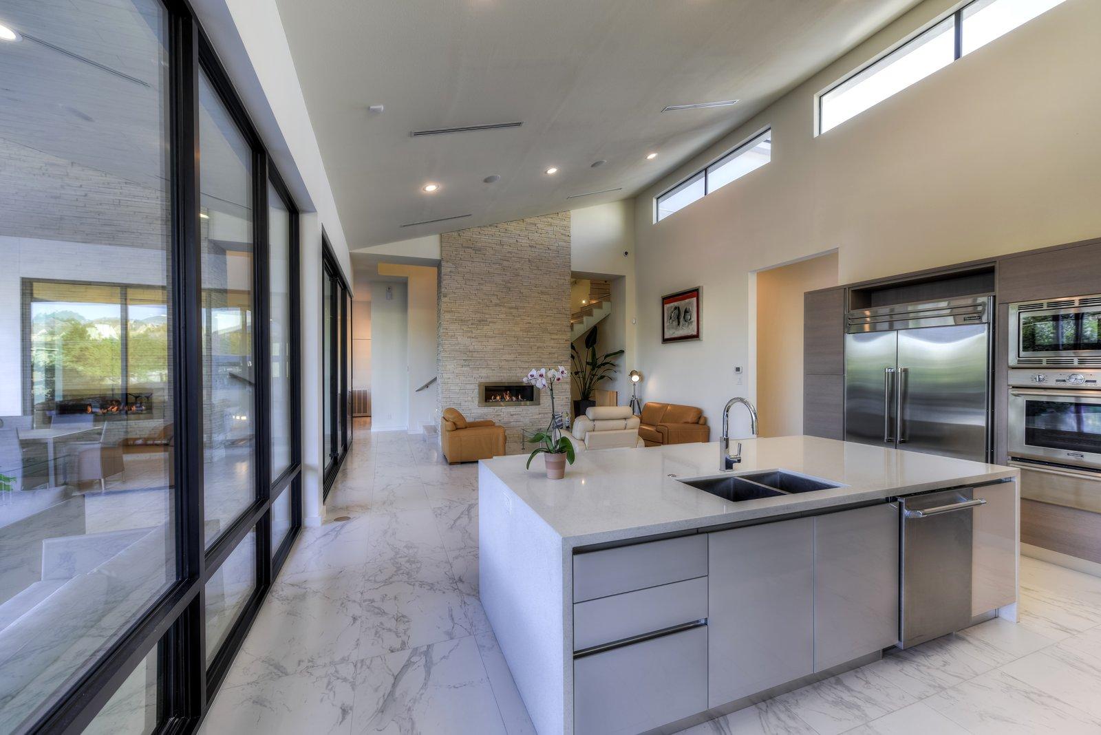 OPEN LIVING KITCHEN AREA  ORVANANOS HOUSE by OSCAR E FLORES DESIGN STUDIO