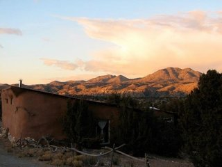 Barnio, one of the straw-bale out building. Cerrillos Hills in the distance