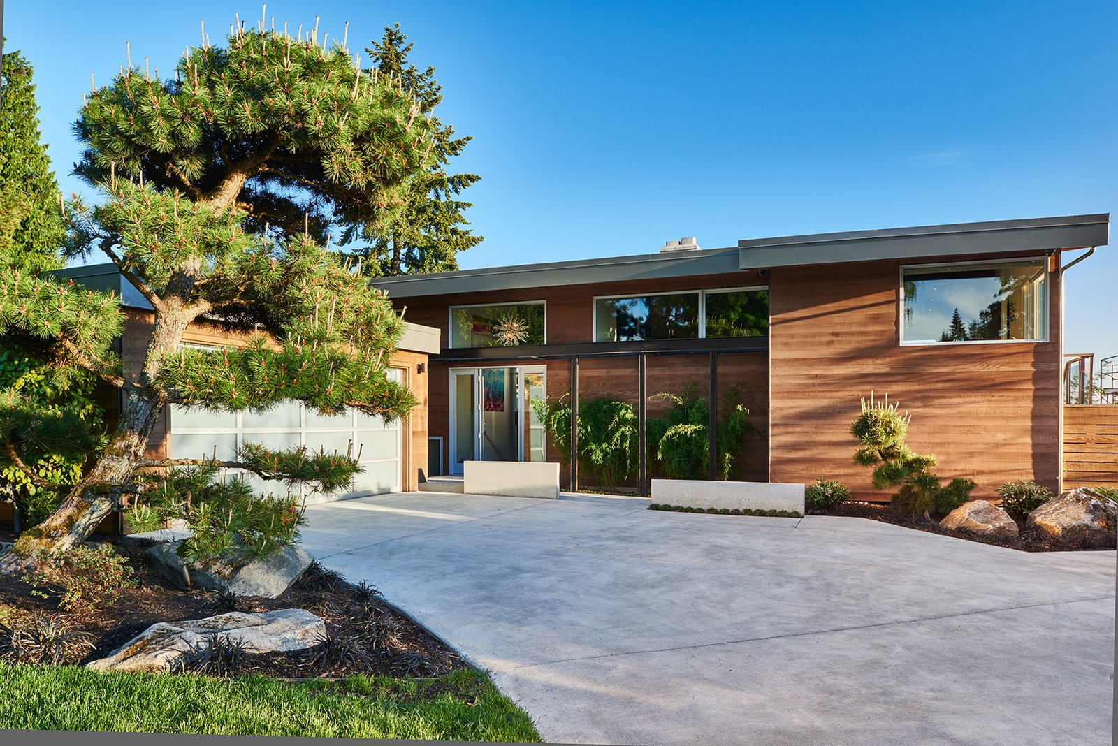 Mid-century, remodeled exterior  Clyde Hill Mid-Century by Garret Cord Werner