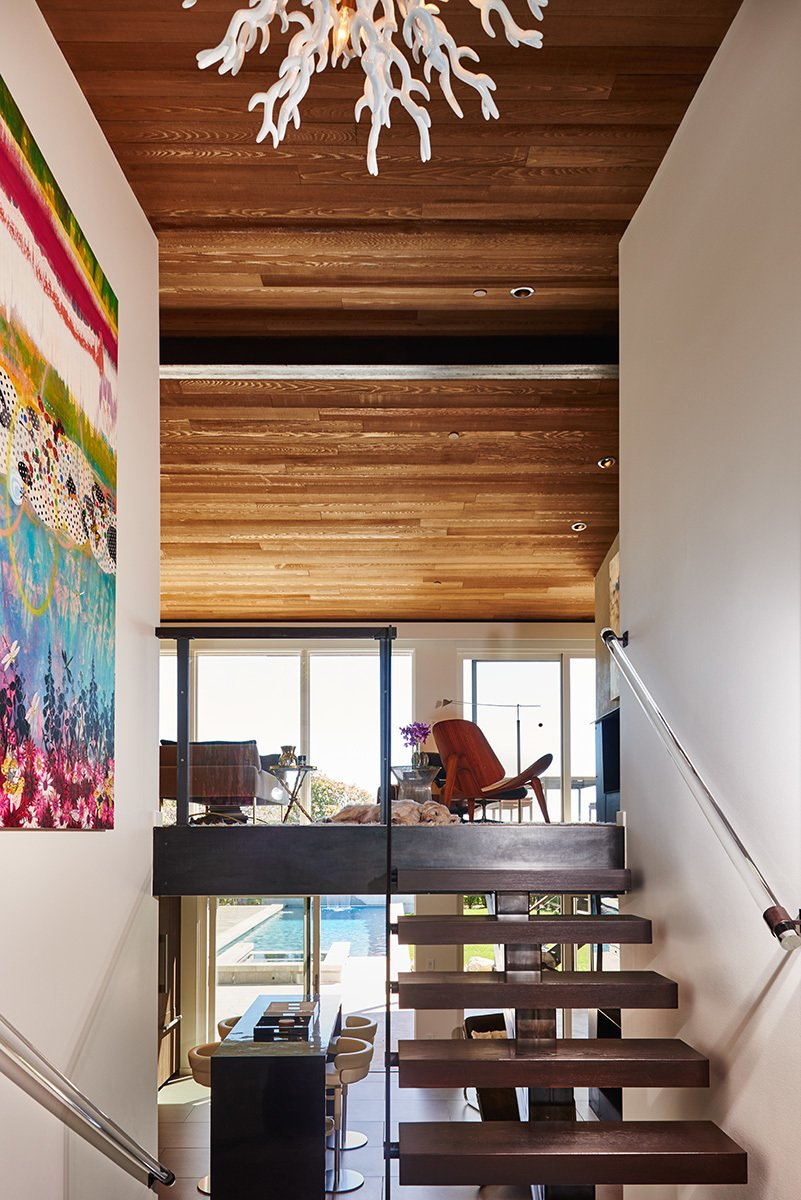 Mid-century, floating entry stairs  Clyde Hill Mid-Century by Garret Cord Werner