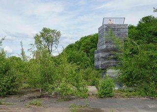 German architecture studio, Modulorbeat, stacked concrete volumes normally used for mine shafts to create a tower housing a tiny sauna.