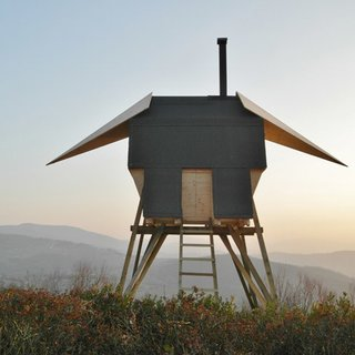 Milan studio AtelierFORTE envisioned a sauna in the northern Italian countryside that has wings like a bird.
