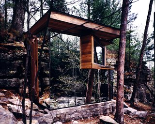 The Cadyville Sauna was designed as a compact structure, covered with mirrors, built up against a cliff.