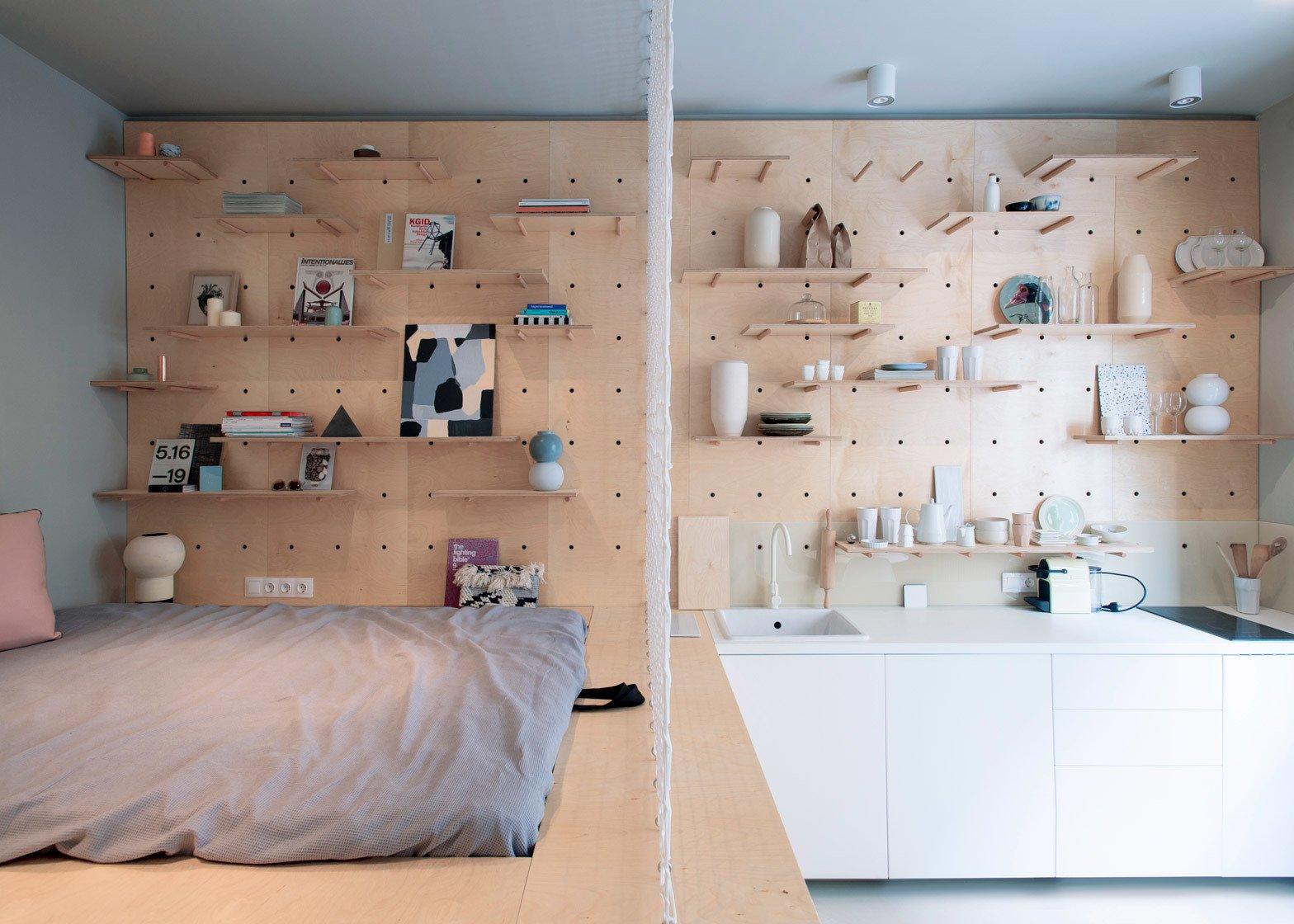 Shelves along light wood pegboard.