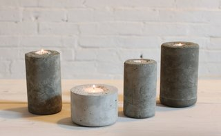 These industrial candleholders were made with a concrete mix that was casted in plastic water bottles. DIY designer Ben Uyeda of HomeMade Modern layered in different colors of concrete to create a fading, ombre effect.