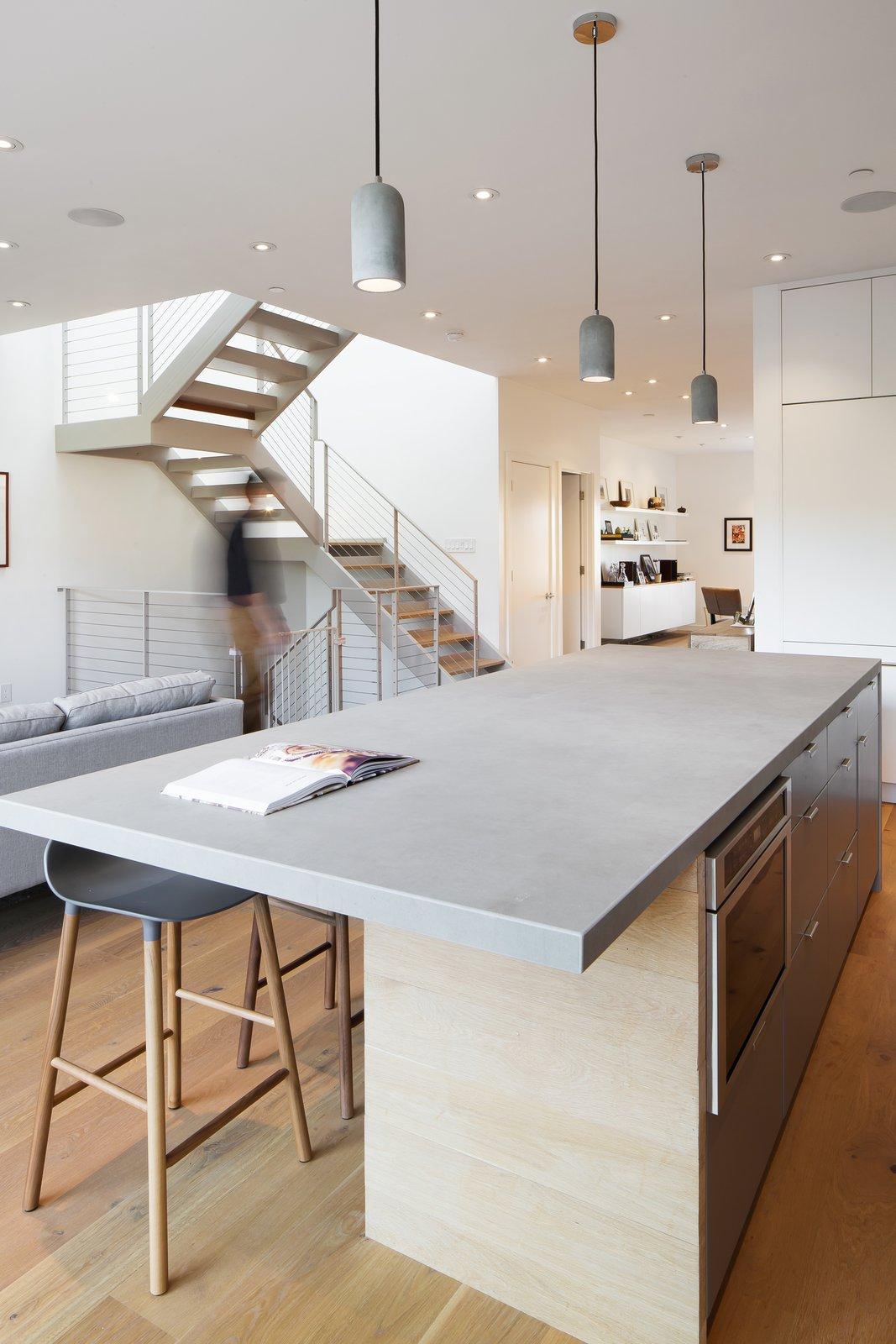 San Francisco Renovation kitchen island with grey quartz countertops and grey pendant lighting