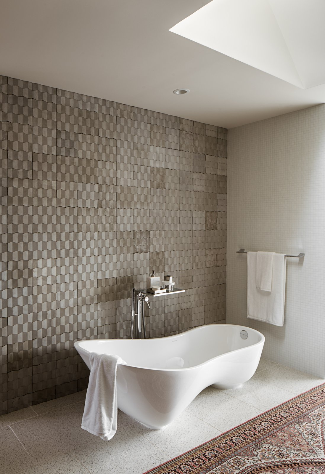 Bath Room, Porcelain Tile Floor, Freestanding Tub, Recessed Lighting, and Stone Tile Wall Master bath  River Garden Trail Residence by Texas Construction Company