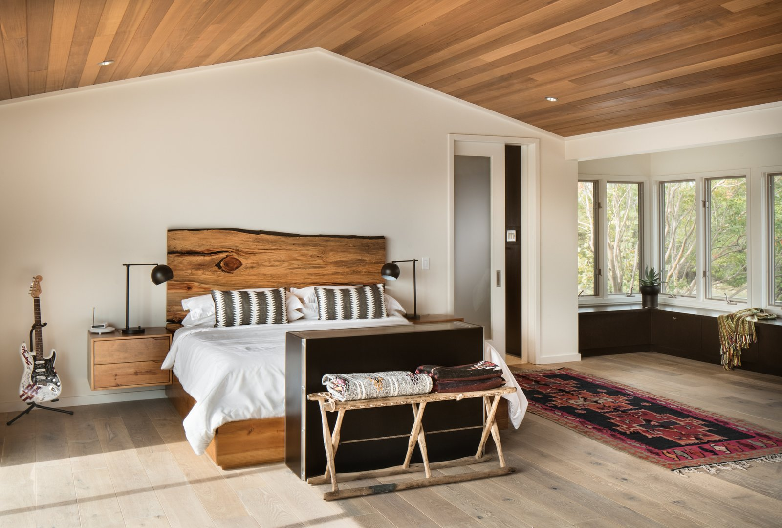 Bedroom, Bed, Storage, Recessed Lighting, Night Stands, and Light Hardwood Floor Master bedroom  River Garden Trail Residence by Texas Construction Company