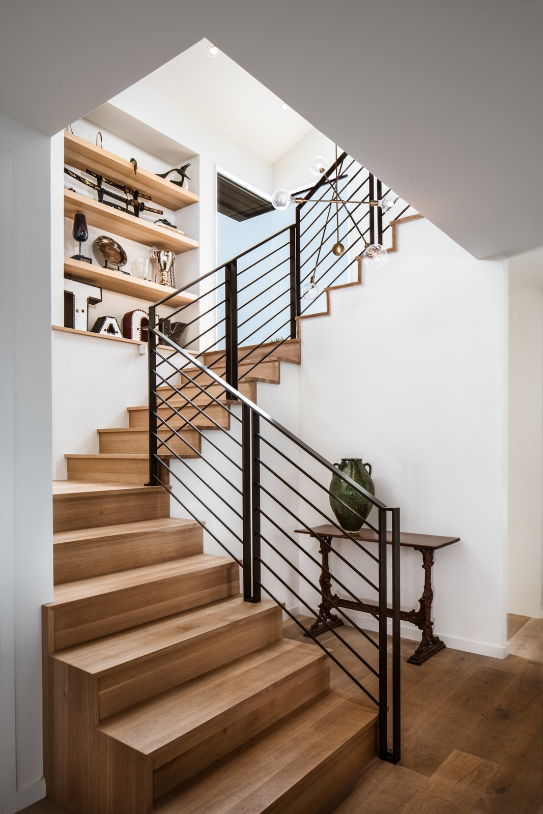 Staircase, Metal Railing, and Wood Tread Stairs  River Garden Trail Residence by Texas Construction Company