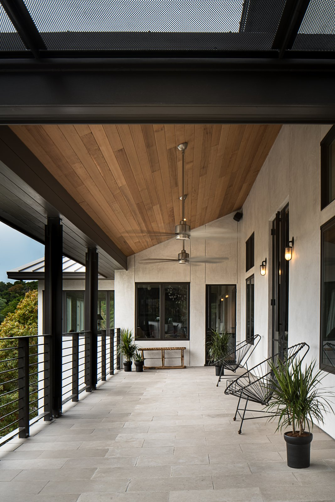 Outdoor and Stone Patio, Porch, Deck Back porch  River Garden Trail Residence by Texas Construction Company