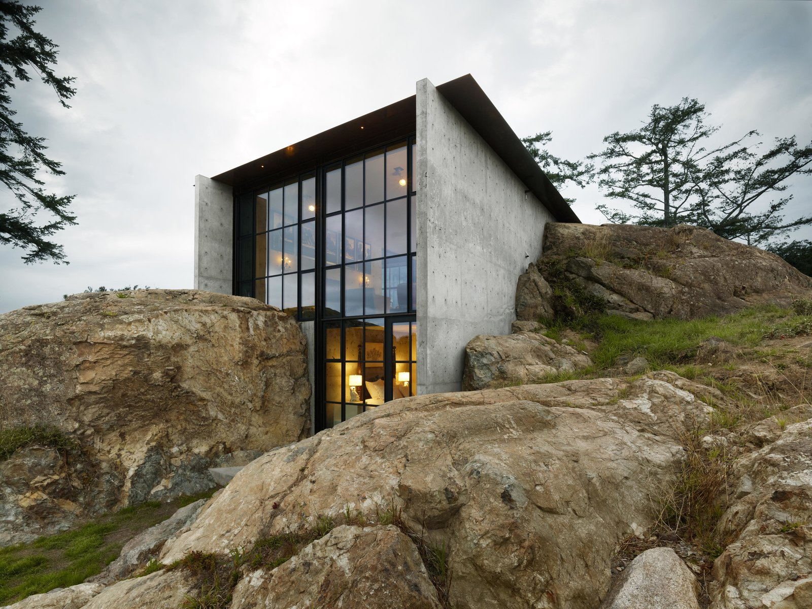 Boulders, Slope, Exterior, House Building Type, Concrete Siding Material, Shed RoofLine, and Glass Siding Material The Pierre | Olson Kundig  Best Photos from The Pierre