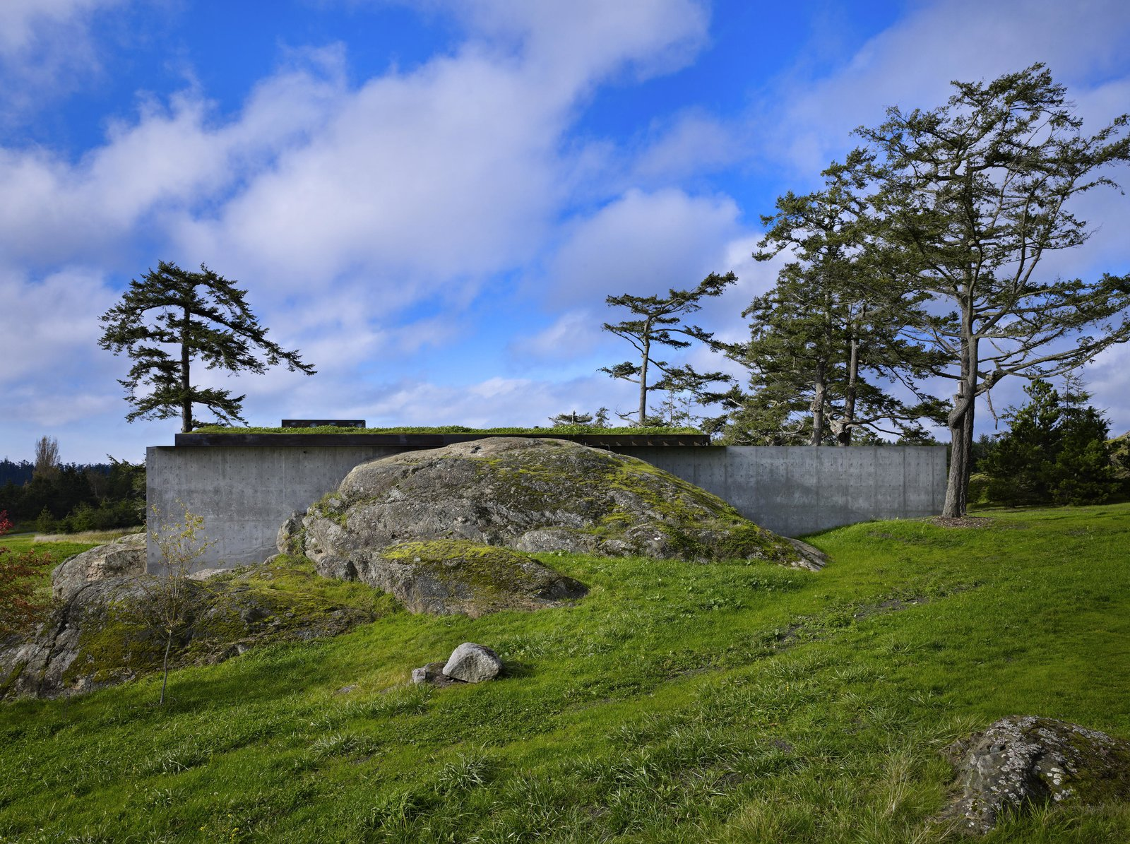 Outdoor, Boulders, Grass, and Trees The Pierre | Olson Kundig  The Pierre