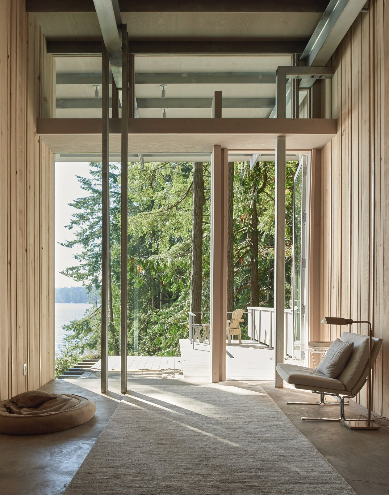 Living Room, Chair, and Rug Floor Cabin at Longbranch | Olson Kundig  Photo 5 of 6 in Top 5 Homes of the Week With Amazing Outdoor Spaces from Cabin in Longbranch