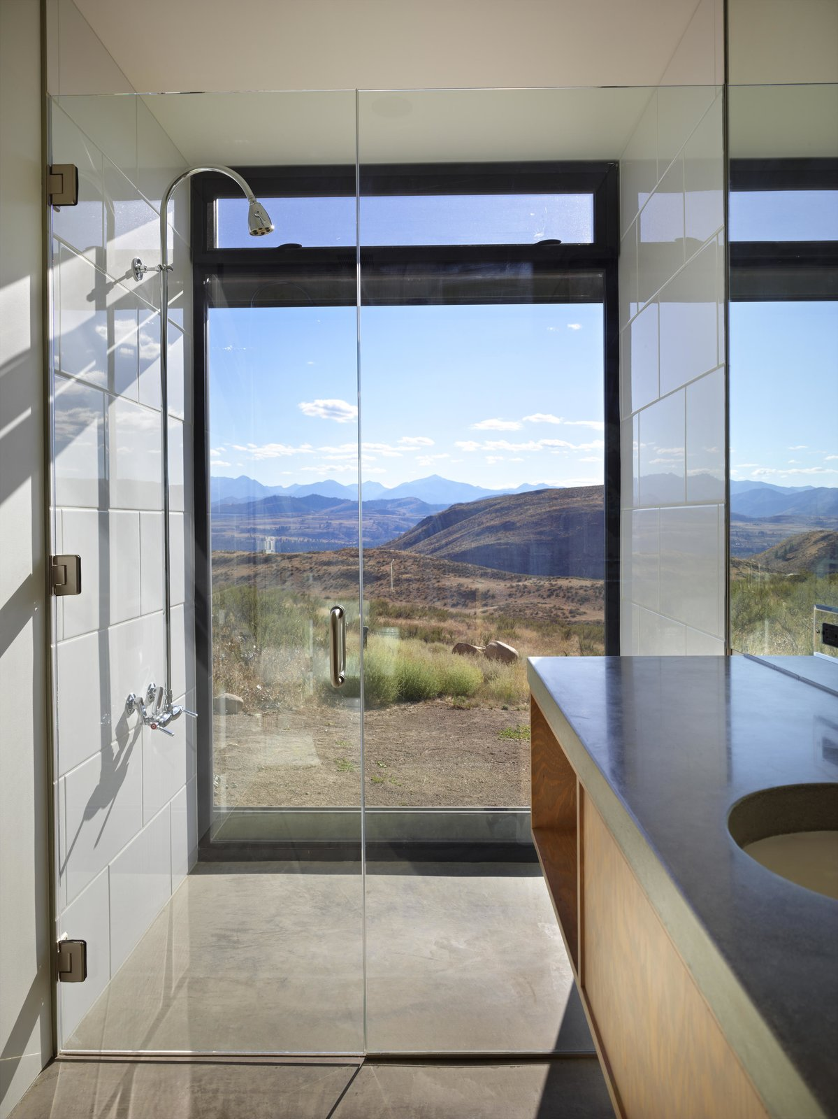 Bath Room, Undermount Sink, Concrete Counter, Ceramic Tile Wall, and Full Shower Studhorse   Olson Kundig  Studhorse by Olson Kundig
