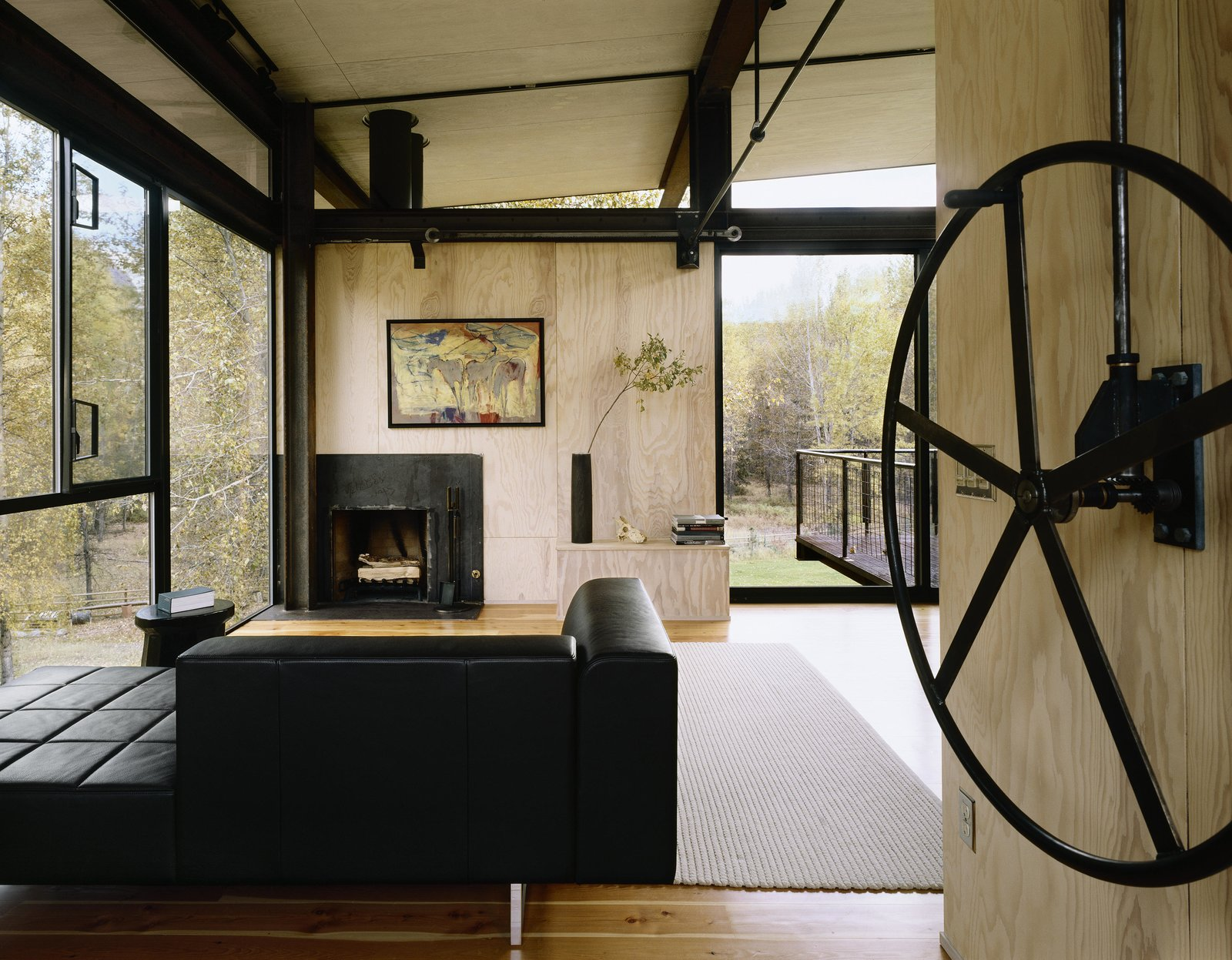 Living Room, Standard Layout Fireplace, Sofa, and Medium Hardwood Floor Delta Shelter | Olson Kundig  Delta Shelter by Olson Kundig
