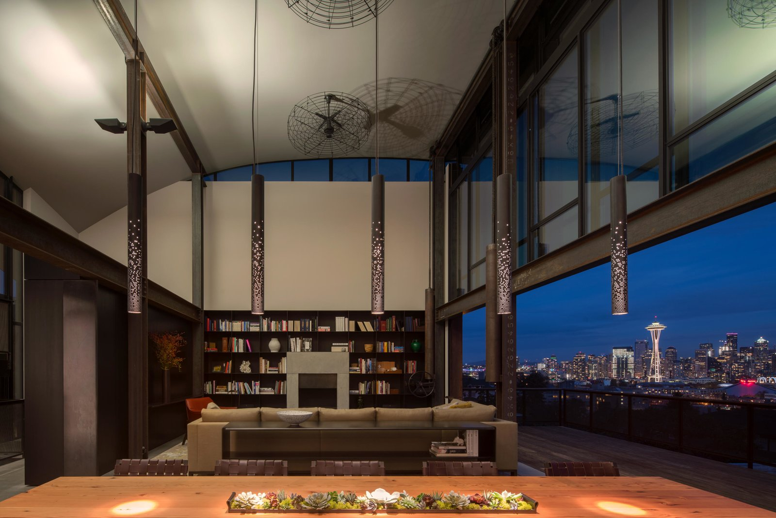 Living Room, Chair, Sofa, Sectional, Coffee Tables, Console Tables, Bookcase, Pendant Lighting, Ceiling Lighting, Recessed Lighting, Concrete Floor, and Standard Layout Fireplace Meg Home | Olson Kundig  Meg Home by Olson Kundig