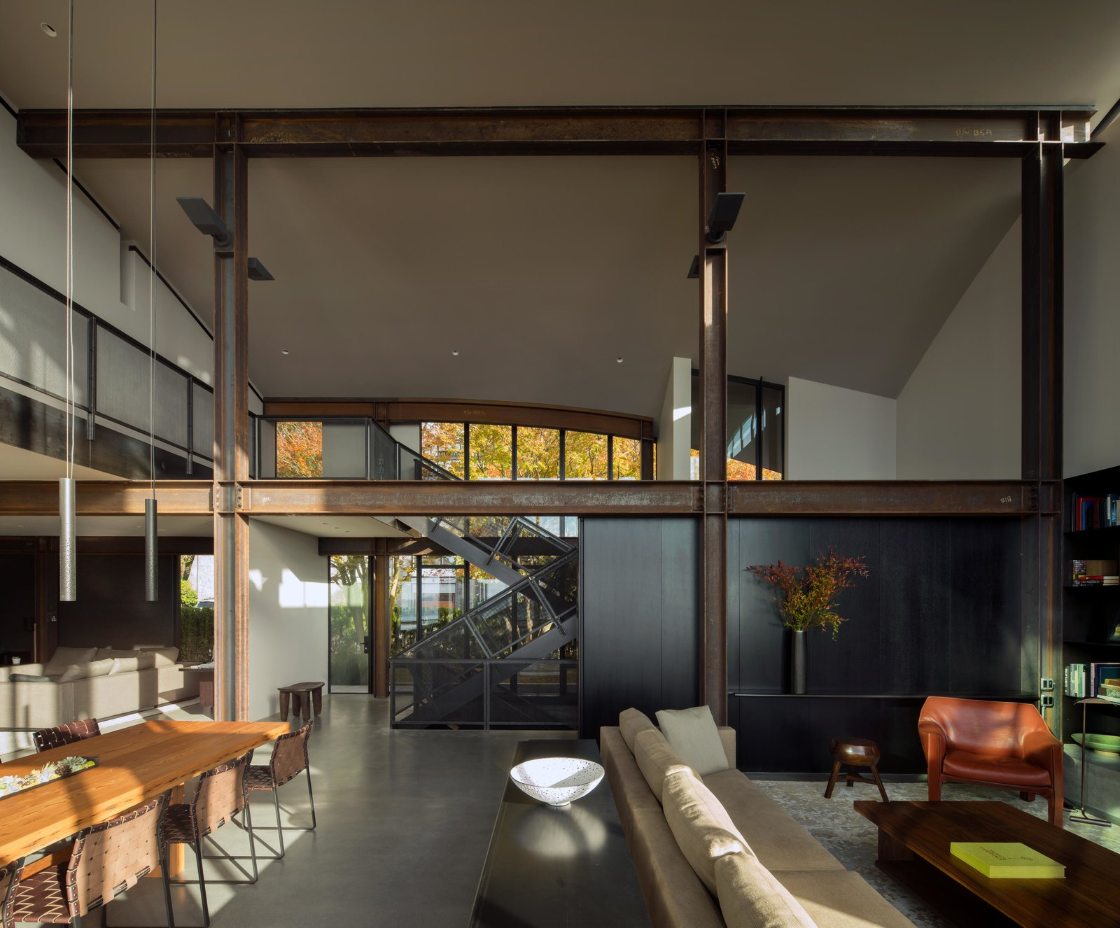 Living Room, Sofa, Sectional, Coffee Tables, Console Tables, Bookcase, Pendant Lighting, Ceiling Lighting, Recessed Lighting, and Concrete Floor Meg Home | Olson Kundig  Meg Home by Olson Kundig