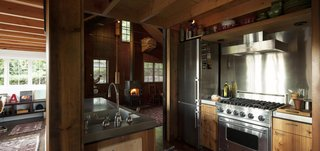 Agate Pass Cabin | Original wood siding was saved from the demolition and reused on all kitchen casework.