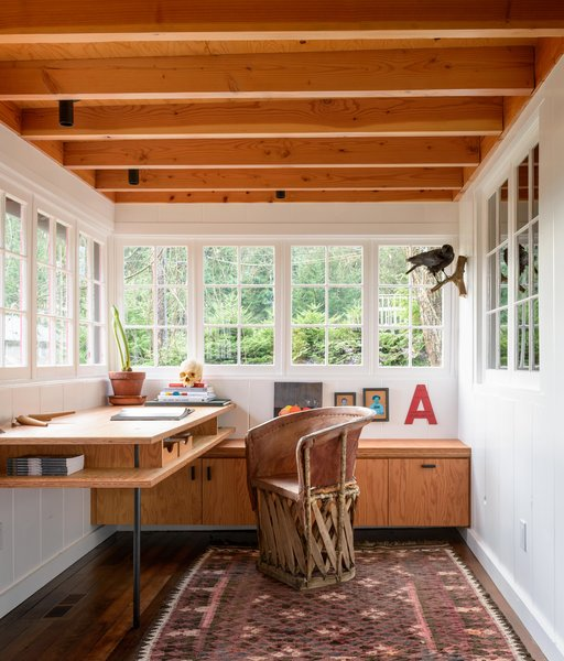 Agate Pass Cabin | The former porch was transformed into an office and dining room.