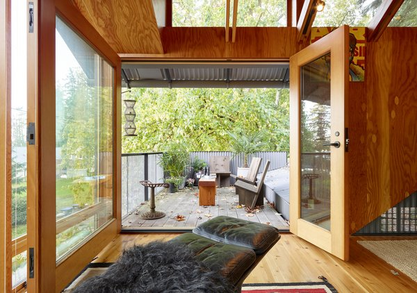 Agate Pass Cabin | A porch was added providing an outdoor room with views of Agate Pass | 'Longbranch Chairs' designed by Jim Olson, Olson Kundig.