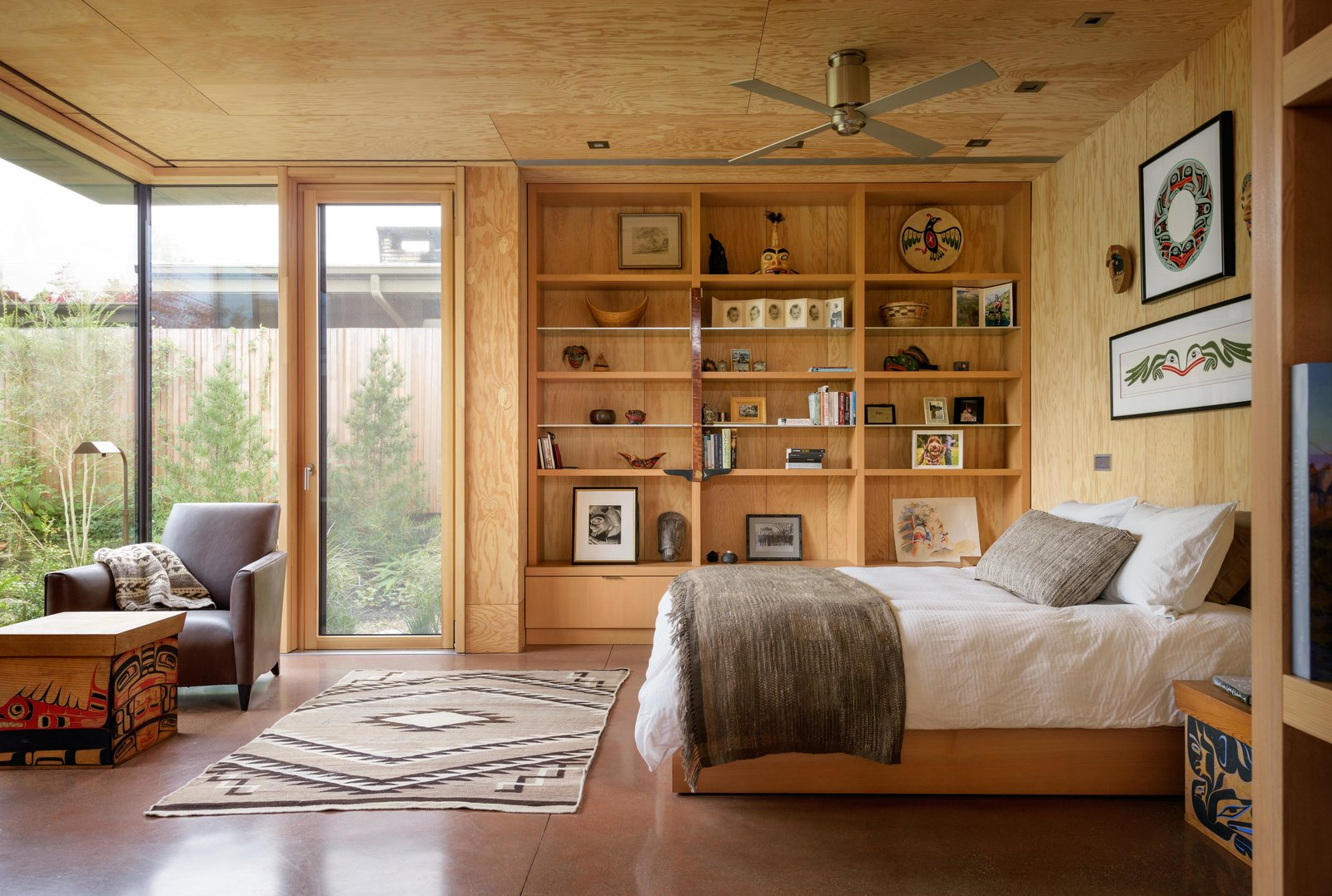 Bedroom, Concrete Floor, Storage, Shelves, Bed, Night Stands, Bookcase, and Chair City Cabin | Olson Kundig  Photo 11 of 13 in Immersed in Nature, This City Cabin Targets Net-Zero Energy from City Cabin