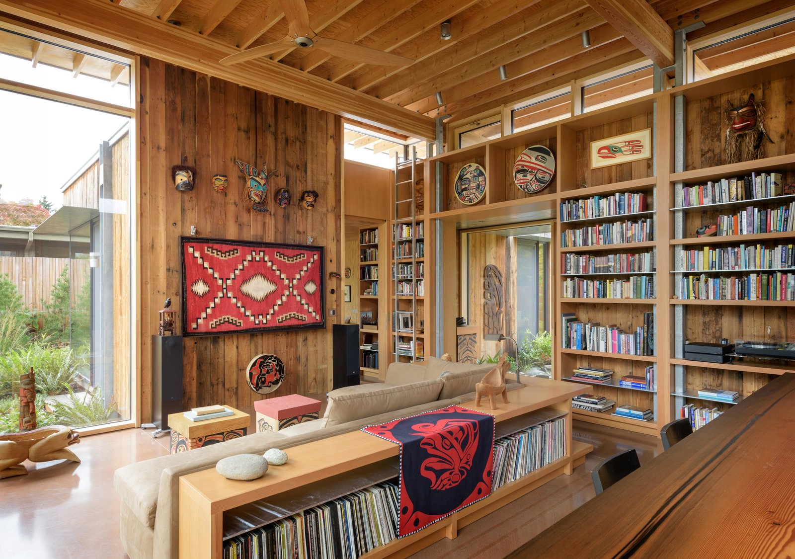 Living Room, Sofa, End Tables, Sectional, Concrete Floor, Bookcase, and Coffee Tables City Cabin | Olson Kundig  Photo 7 of 13 in Immersed in Nature, This City Cabin Targets Net-Zero Energy from City Cabin