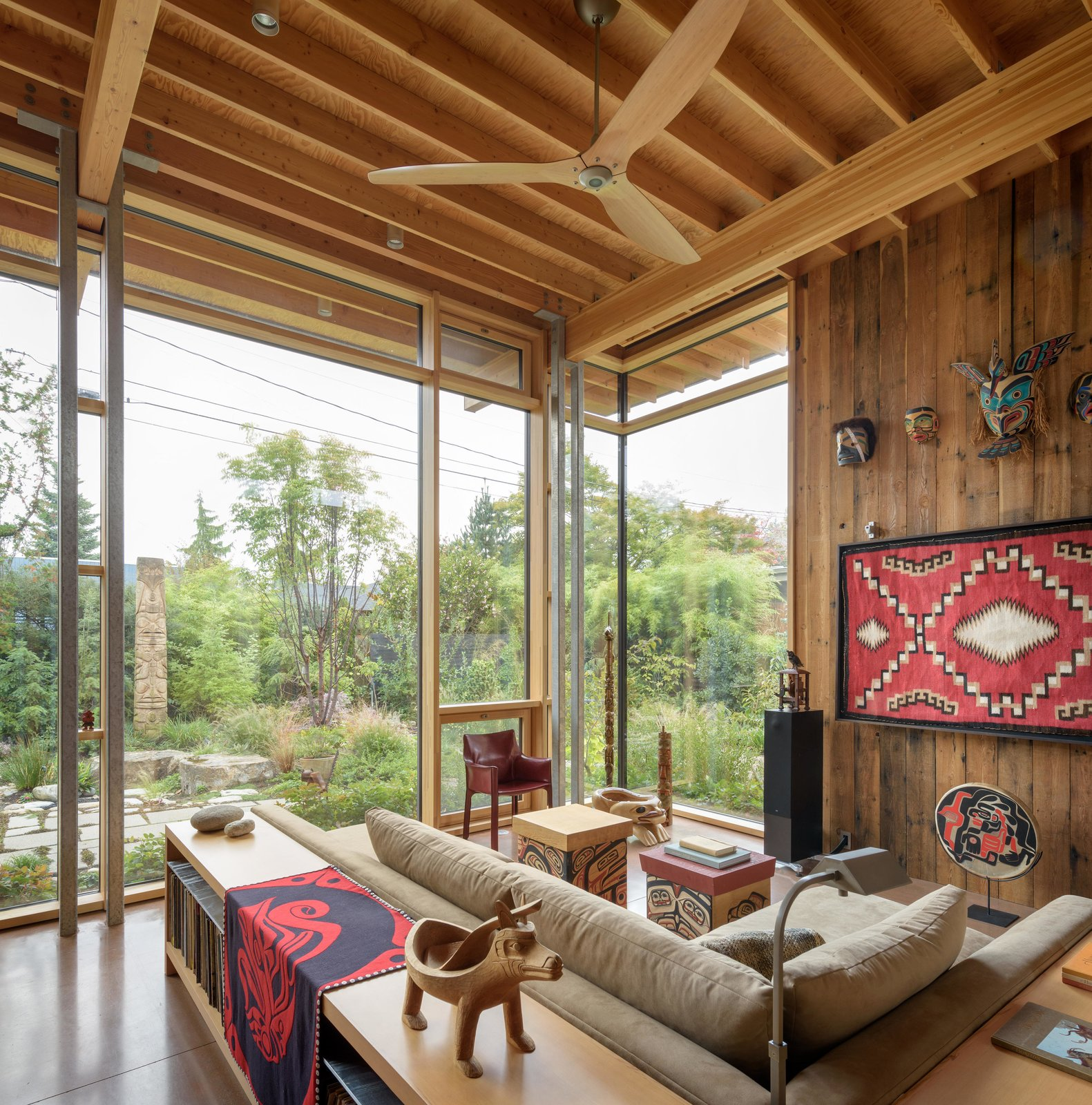 Living Room, Concrete Floor, Sectional, Sofa, Chair, Console Tables, Coffee Tables, and End Tables City Cabin   Olson Kundig  Photo 4 of 13 in Immersed in Nature, This City Cabin Targets Net-Zero Energy from City Cabin