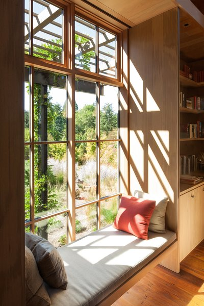 Olson Kundig's Country Garden House ekes out as much window space as possible. Gardens designed in collaboration with notable plantsman Dan Hinkley are visible from every room, and window walls in the living area allow the gardens to become a part of the home.
