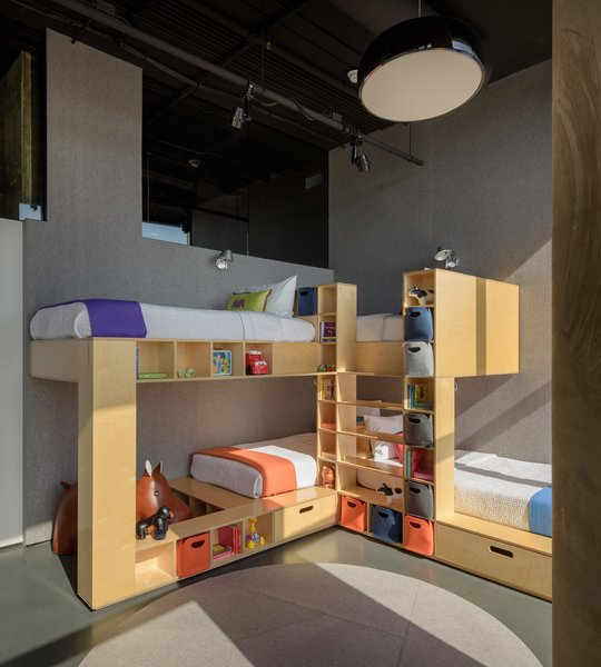 Tom Kundig designed custom pieces of furniture to define each space throughout the apartment—such as these bespoke bunk beds in the children's room that are both playful and creative.