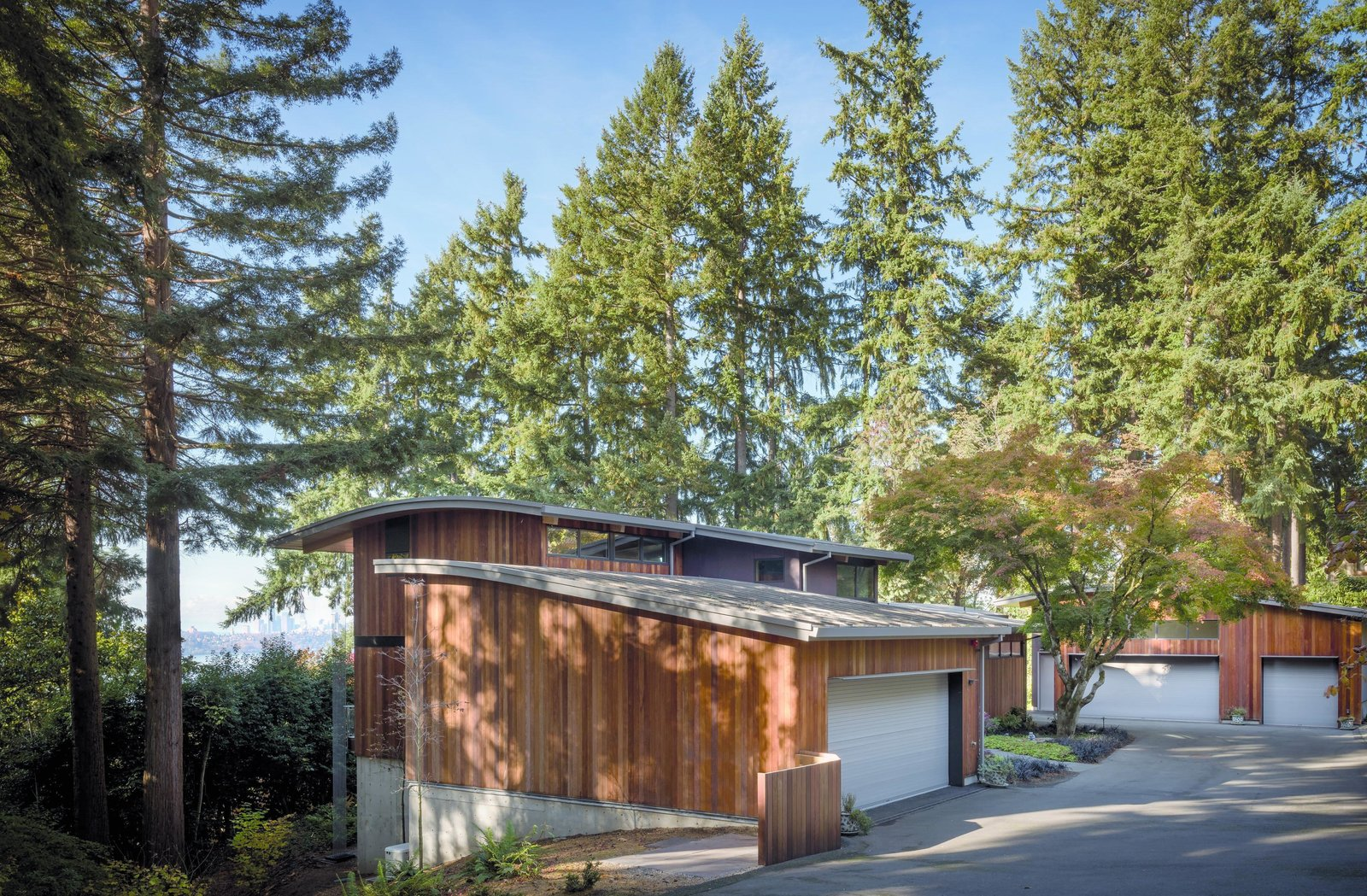 Exterior, House Building Type, Wood Siding Material, Curved RoofLine, and Concrete Siding Material Wave House | Olson Kundig  Wave House by Olson Kundig
