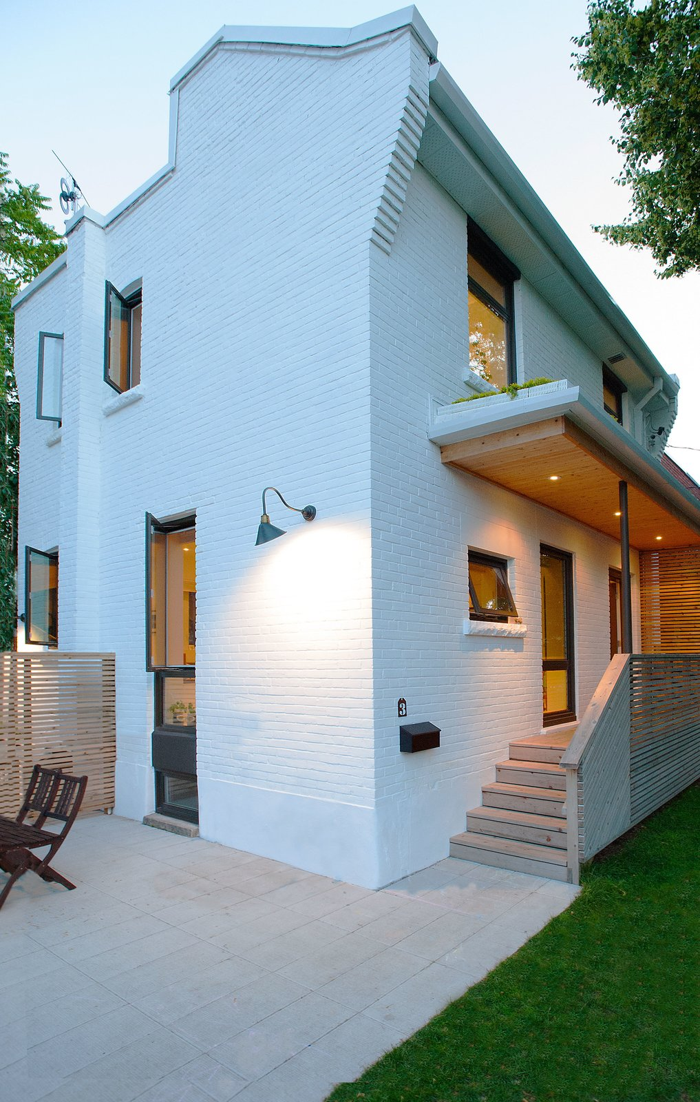 Outdoor, Front Yard, Side Yard, Grass, Horizontal Fences, Wall, and Wood Fences, Wall Our House - Exterior  Our House by Solares Architecture