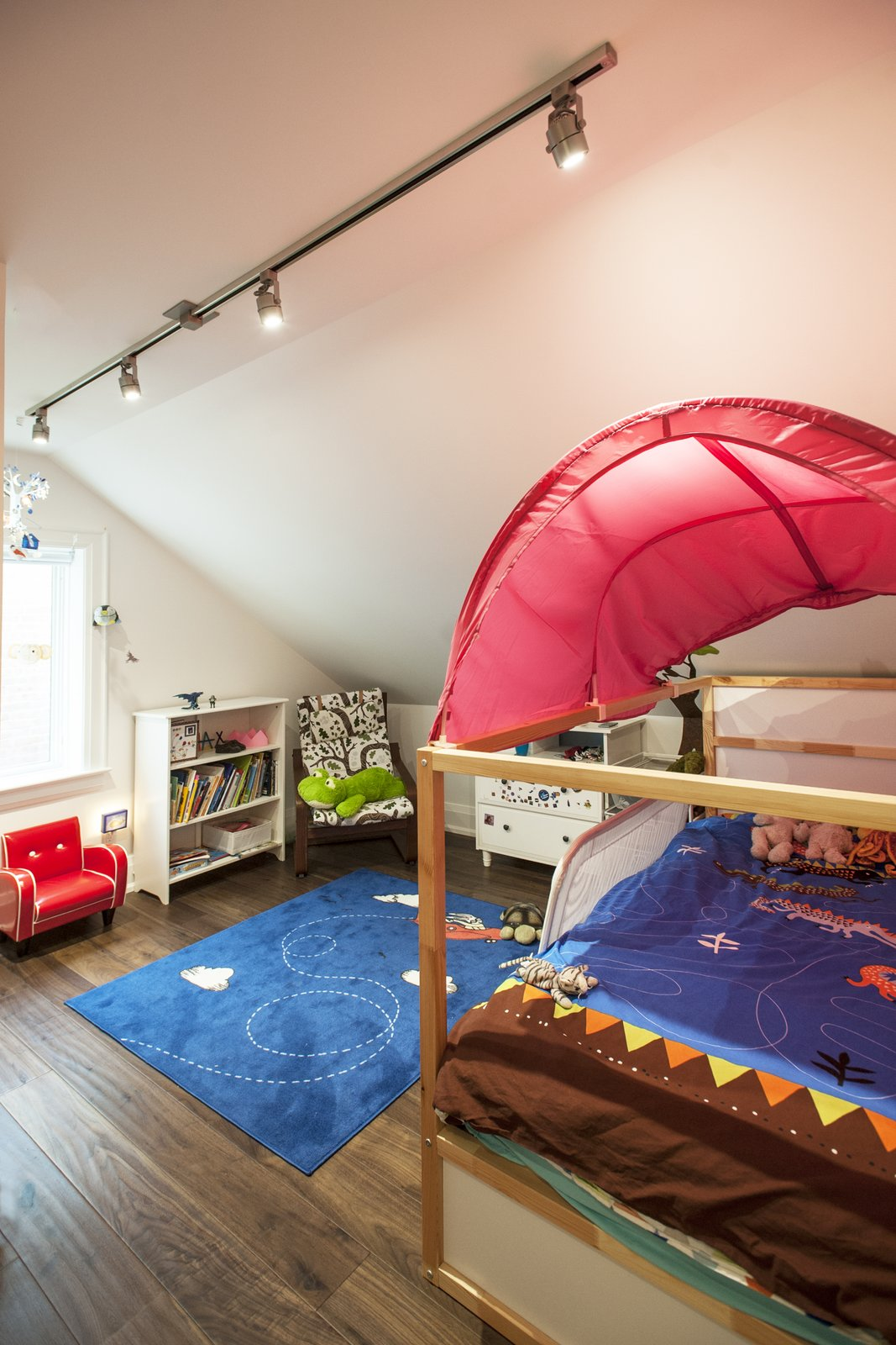 Kids Room, Bed, Storage, Bedroom Room Type, Bookcase, and Dark Hardwood Floor Bickford Park - Kids Room  Bickford Park by Solares Architecture