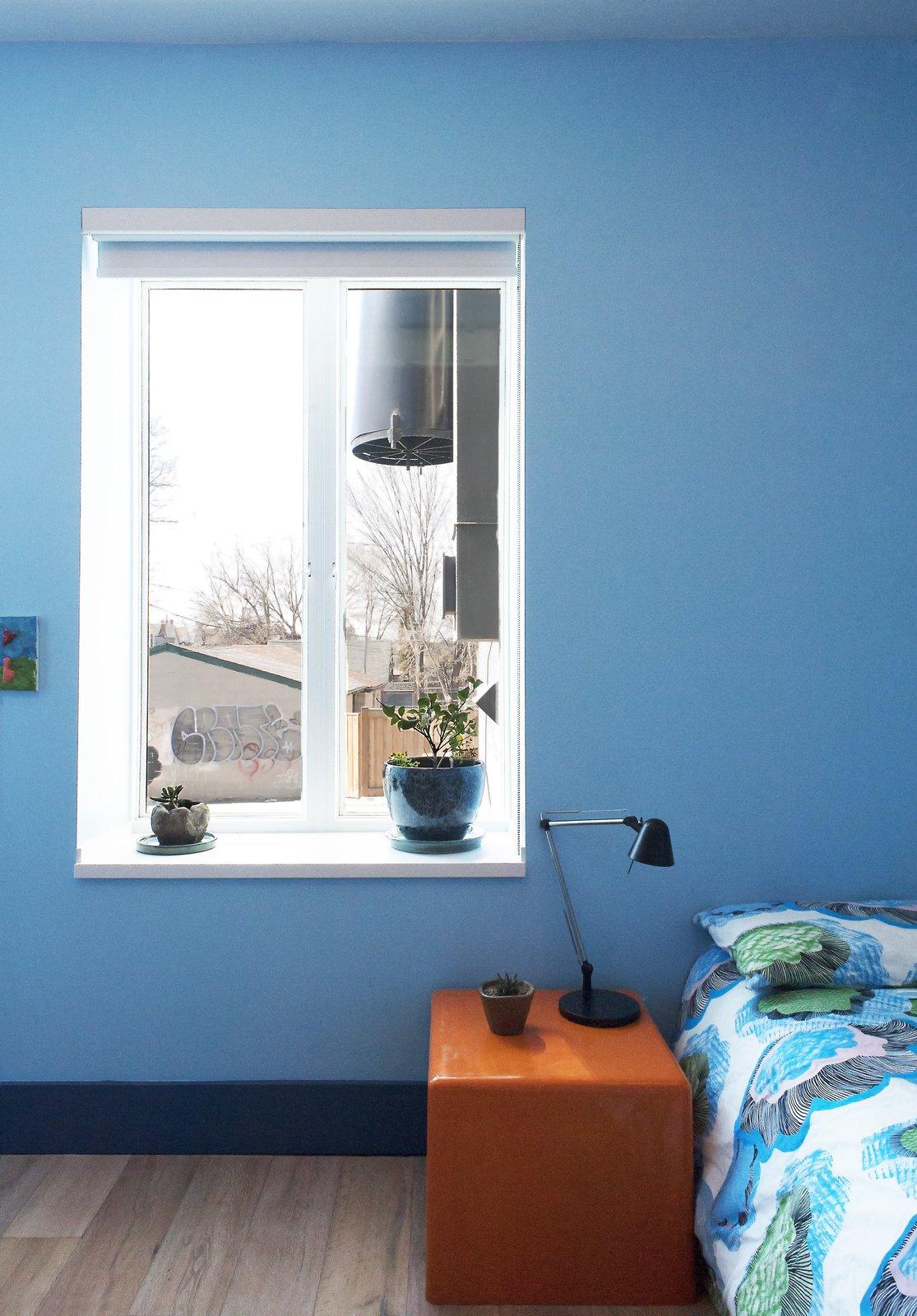 Bedroom, Night Stands, Storage, Lamps, Bed, Table Lighting, and Light Hardwood Floor Elgin Loft - Kids' Bedroom  Best Photos from Elgin Loft