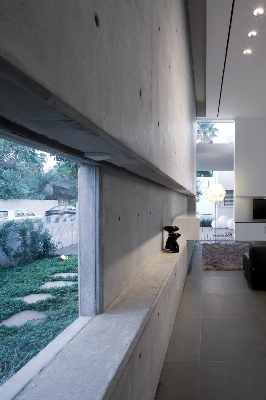 Many smaller glazed areas reveal hidden views of exterior garden.  eHouse by Axelrod Architects