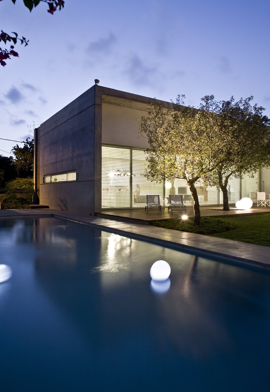 The site is masterfully landscaped and includes several decks and a reflecting pool.  eHouse by Axelrod Architects