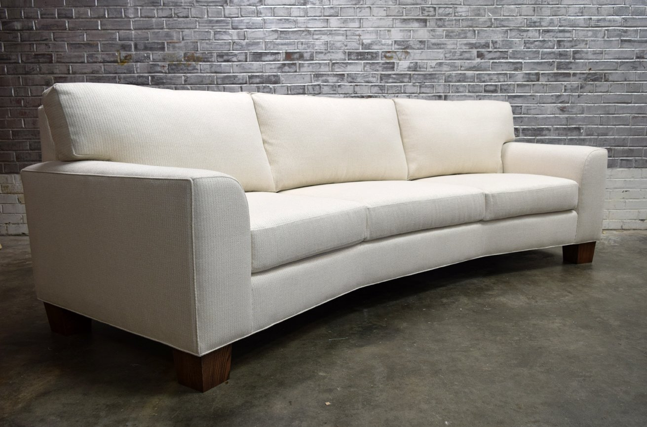 This custom Heidi sofa was built with the slightest curve to frame the client's seating space. Built with all non-toxic and natural materials, this piece is both a safe and luxurious choice for your home.  The Heidi